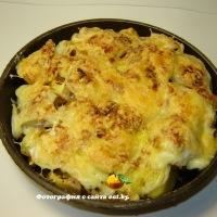 Картошка запеченная с курицей под сыром